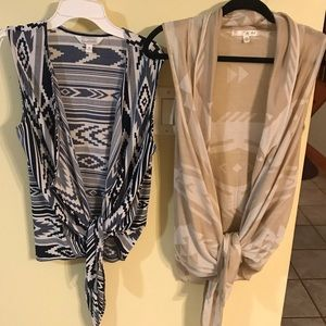 Two Aztec patterned knit vests.